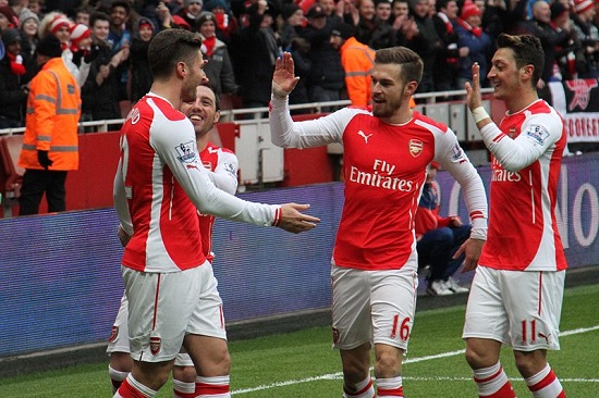 Ozil and Ramsey with their team mates